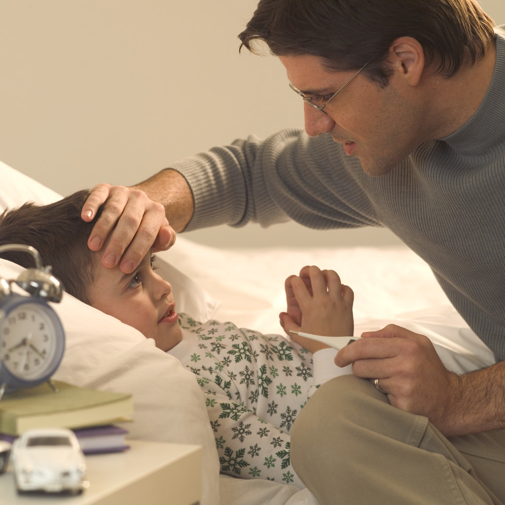 Father Checking Son's Forehead for Fever