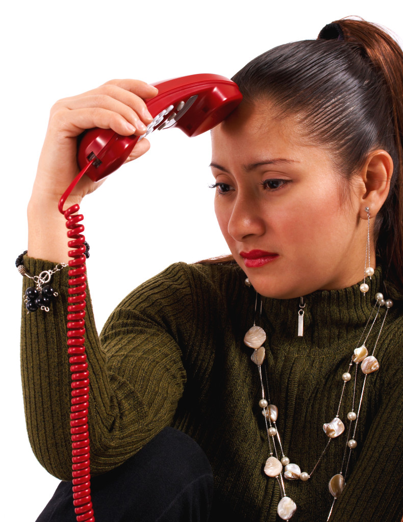 Woman Receiving Distressing Phone Call