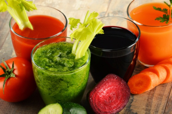 Glasses with fresh organic vegetable juices on wooden table. Detox diet