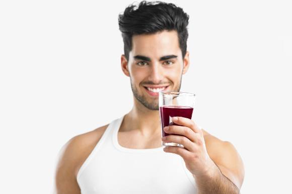 Man Holding out Glass of Juice