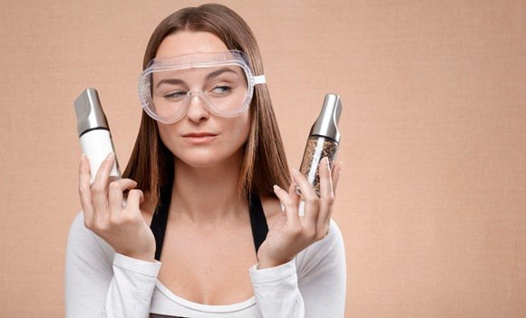 Woman With Googles Holding Salt and Pepper